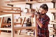 Man sanding down chair | mavo/Shutterstock.com