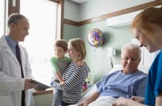 Doctor talking to patient's family   Hero Images/Getty Images