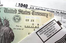 United States Treasury tax refund check and tax form © iStock