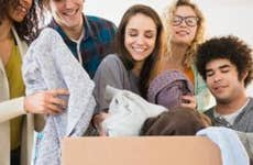 Millennials dropping off clothes to a donation outbox | JGI/Jamie Grill/Getty Images