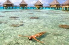 Woman swimming in vacation resort   M Swiet Productions/Moment/Getty Images