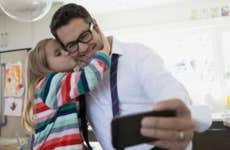 Father taking a selfie with his daughter   Hero Images/Getty Images