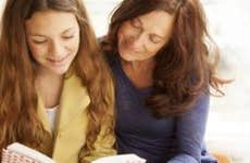 Mother and daughter reading a book   Brainsil/E+/Getty Images