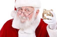 Santa smiling holding a piggy bank  © LuckyBusiness Photo Studio by Igor Mojzes and Agota Janosi - Fotolia.com