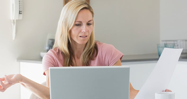 Woman exasperated by bills © iStock