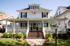 Colonial-style house with flags hanging   Nine OK/Getty Images