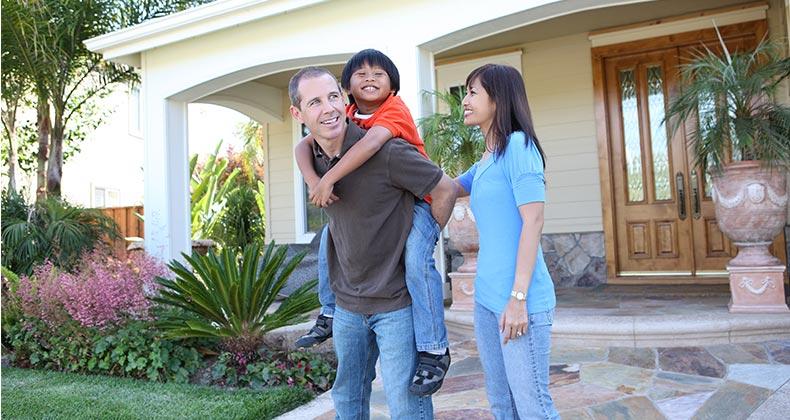 Family standing outside front door   Stephen Coburn/Shutterstock.com