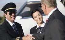 Airplane captain shaking hands with passenger © bikeriderlondon/Shutterstock.com