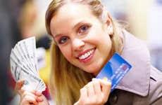 Beautiful lady holding cash and credit card © Yuri Arcurs - Fotolia.com