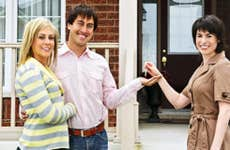 Young couple receiving keys from real estate agent © MJTH/Shutterstock.com