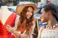 Girlfriends shopping for a dress   David Shopper/Getty Images