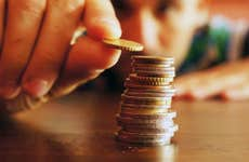 Saving up stacks of coins © Mirco Vacca/Shutterstock.com