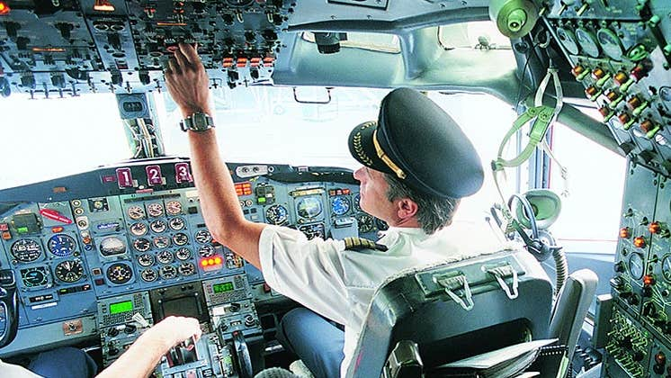 Airplane pilot doing safety checks | James Lauritz/Getty Images