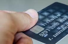 Hand holding titanium credit card © Chookiat K/Shutterstock.com