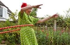 Senior woman in polka dot dress hula-hooping   David Woolley/Getty Images