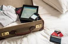 Packing suitcase for a trip | David Cleveland/Getty Images