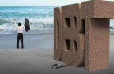 Man in beach free from shackle of debt © iStock