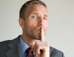 Man gesturing to be quiet, ssshh
