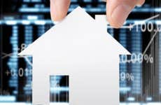 House cutout and financial charts on the background © iStock