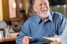 Smiling mature man in job interview meeting | iStock.com/Steve Debenport