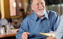 Smiling mature man in job interview meeting   iStock.com/Steve Debenport