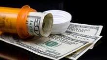 Prescription pill bottle and money