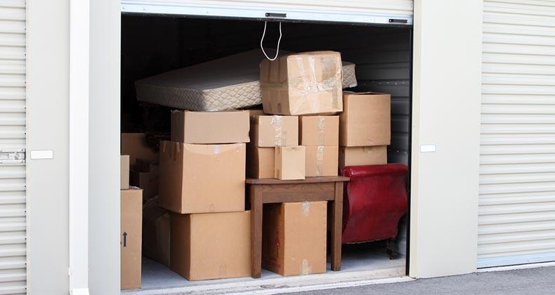 Storage unit full of boxes | NoDerog/E+/Getty Images