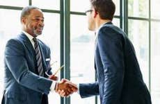 Two businessmen shaking hands   Thomas Barwick/Getty Images