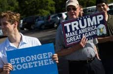 Hillary Clinton and Donald Trump supporters standing side-by-side holding signs   Boston Globe/Getty Images