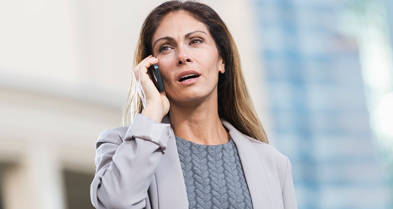 Business woman talking on phone, outside © iStock