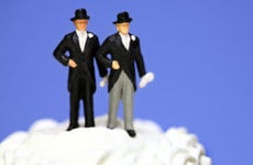 Two grooms on top of wedding cake © Amy Walters/Shutterstock.com