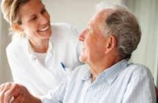 Elderly man speaking to a nurse © iStock