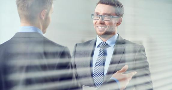 Coworkers talking to each other © iStock