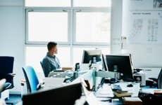 Man sitting alone in an open office