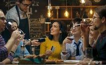Group of friends enjoy wine together at dinner