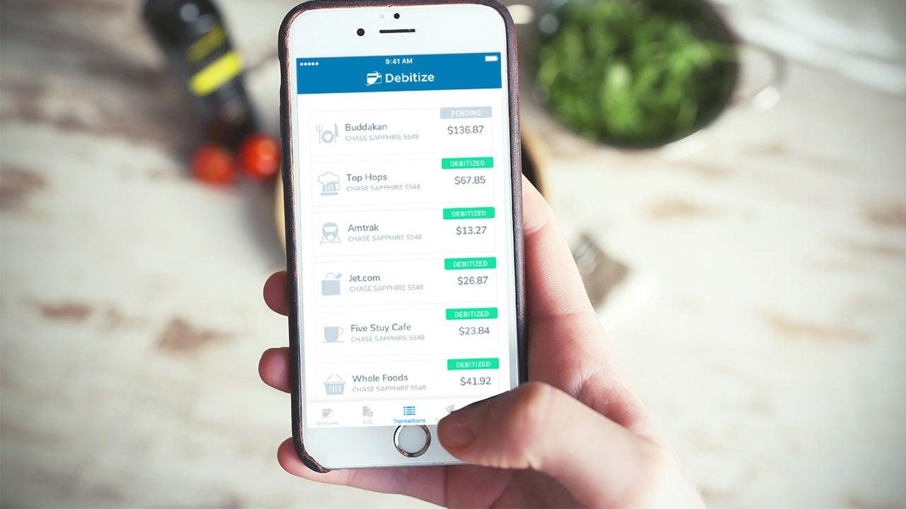 Man using debitize app on phone