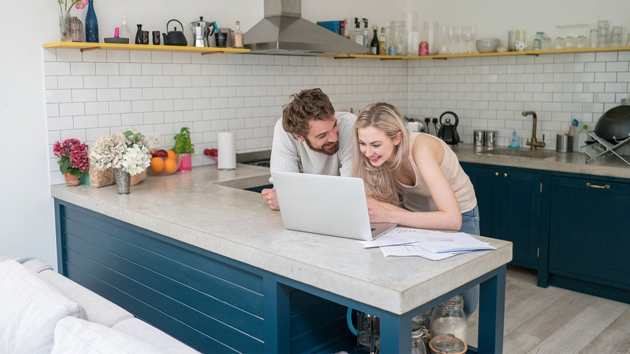 couple viewing credit card offers