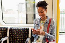 Woman texting on train