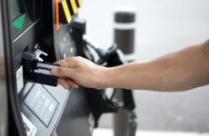 Person using debit card at gas station