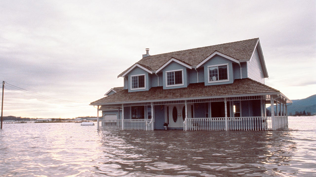 Two-story home inundated by floodwater.
