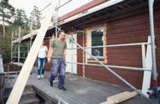 Construction a home with two people inspecting