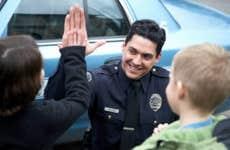 Policeman giving kid high five