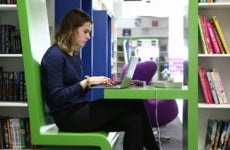 Woman in library on computer