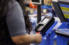 Man using debit card at Walmart