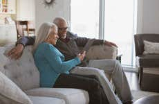 Couple using tablet in livingroom