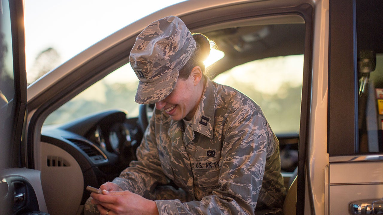 Woman solider checking phone