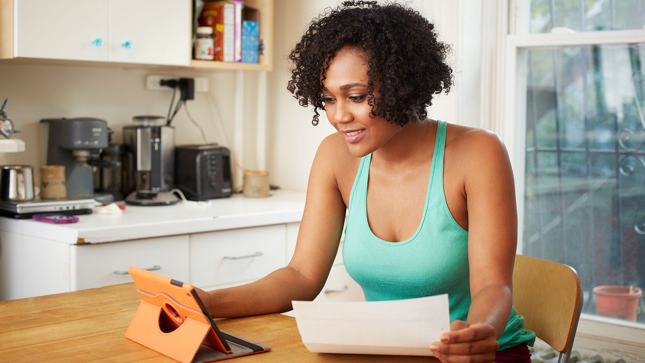 Woman looking at loan on tablet