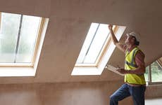 Man inspecting windows in a home inspection