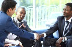 Two men shake hands at a business deal.