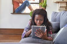 Woman on tablet looking at student loans